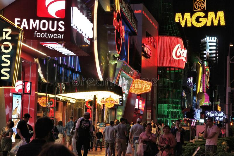 Las Vegas Strip. LAS VEGAS, USA - APRIL 14, 2014: People visit the famous Strip in Las Vegas. 15 of 25 largest hotels in the world are located at the strip with stock photo