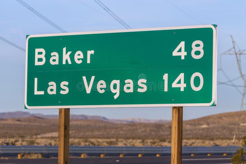 Las Vegas und Bäcker Highway Sign stockbilder