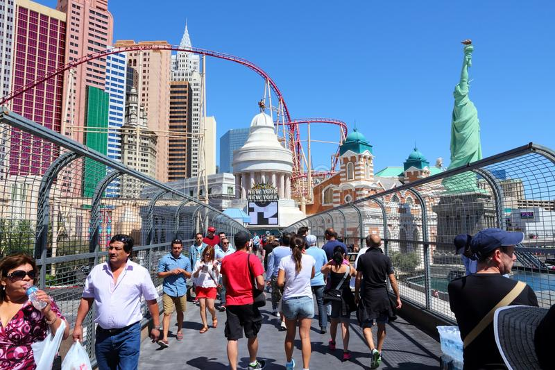 Las Vegas. USA - APRIL 14, 2014: People visit the famous Strip in . 15 of 25 largest hotels in the world are located at the strip with more than 60 thousand stock images