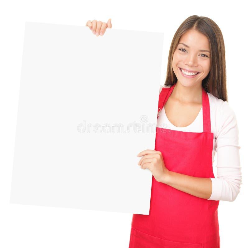 Las ventas clerk mostrar la muestra en blanco foto de archivo libre de regalías