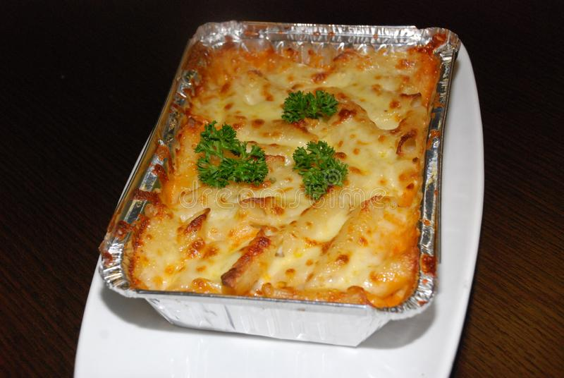 Lasagna in the foil royalty free stock photo