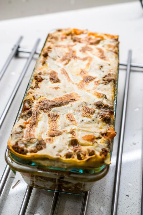 Lasagna with Minced Meat Beef and Bechamel Sauce in Glass Bowl. / Classic Italian Dish stock images