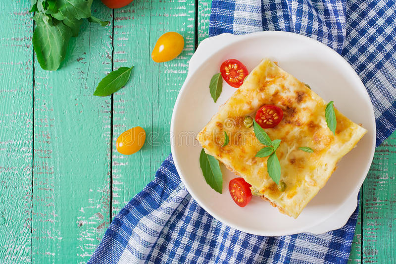 Lasagna with minced meat, green peas. And sauce. Top view royalty free stock images