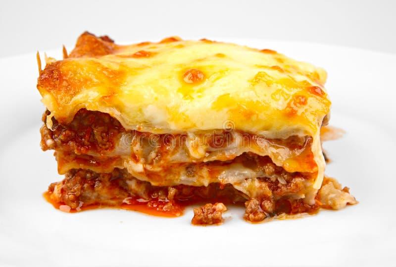 Lasagna no branco fotos de stock royalty free