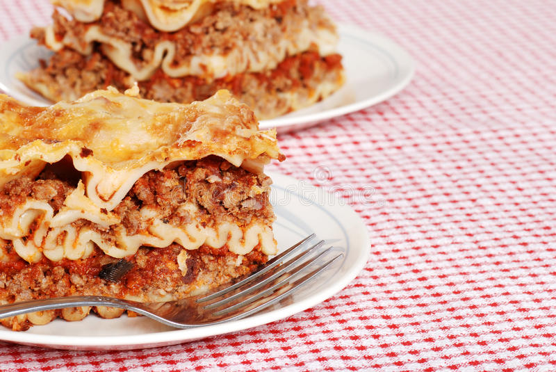 Download Lasagna On Red And White Tablecloth Stock Image - Image of ricotta, plate: 11817873