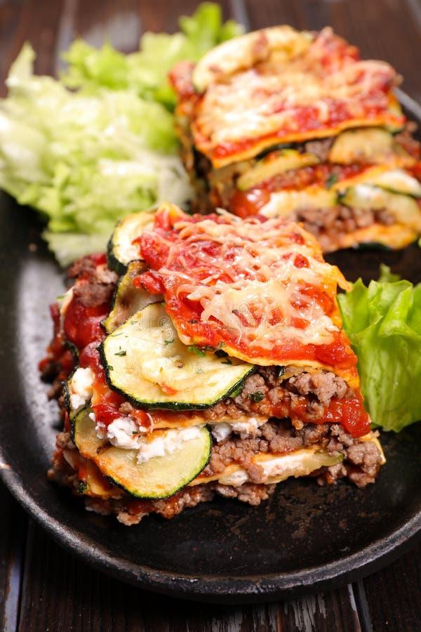 Lasagna and salad stock images