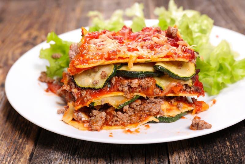 Lasagna and salad stock photo
