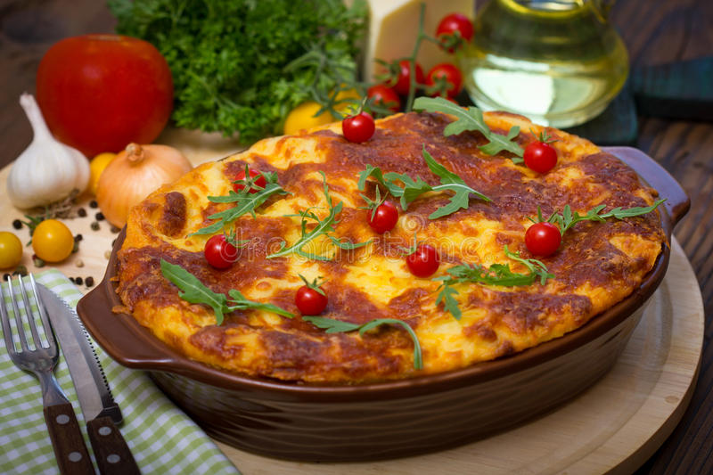 Lasagna on the table. Close up royalty free stock photography