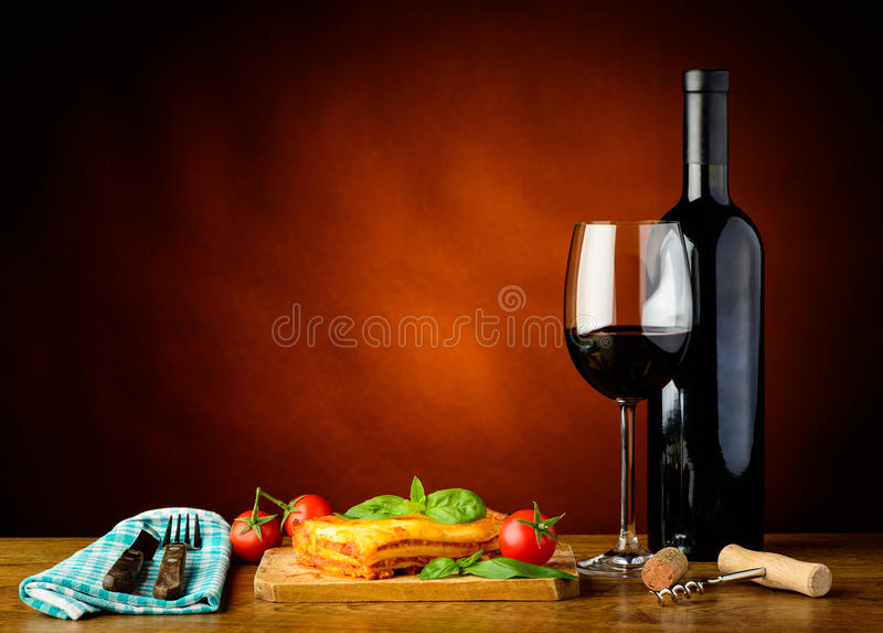 Lasagne bolognese dinner and red wine stock photo