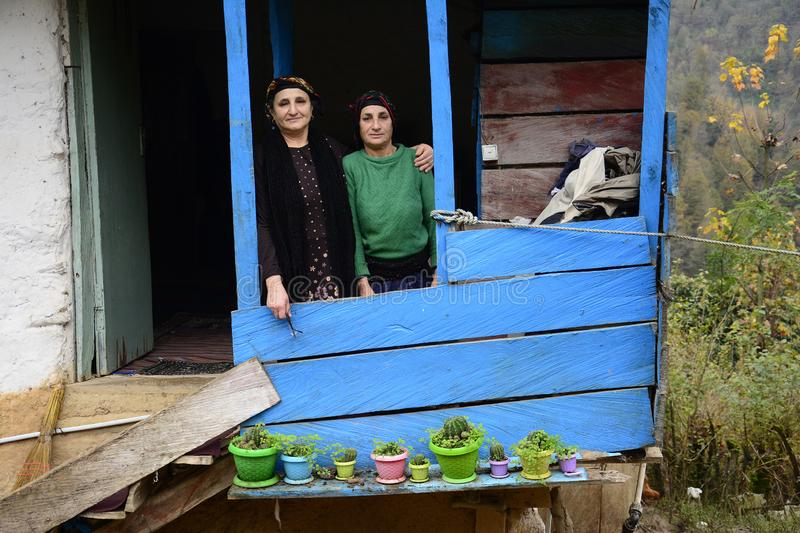 Lasak IRAN - November 22 2018 close up portrait of two elderly woman in front of balcony stock photography