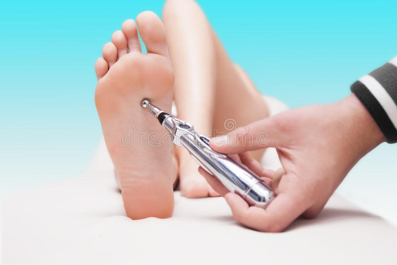 Laser acupuncture stock image