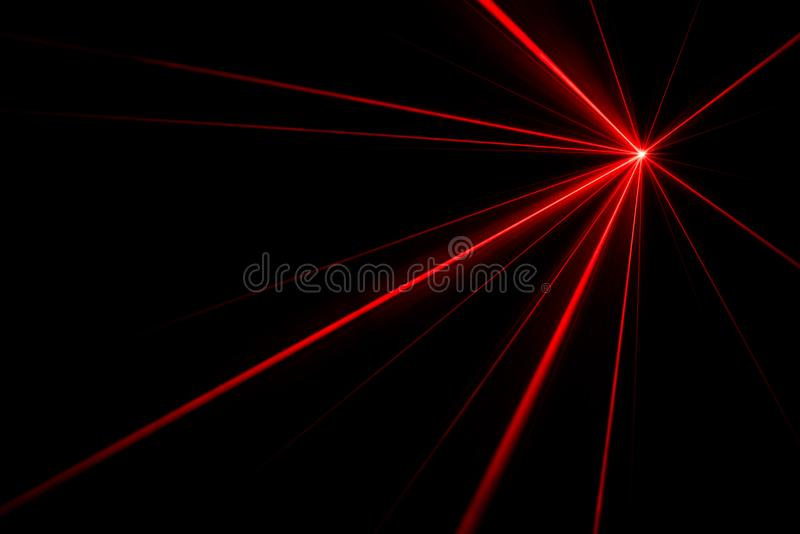 Laser beam light effect. Red laser beams light effect on black background photo royalty free stock photos