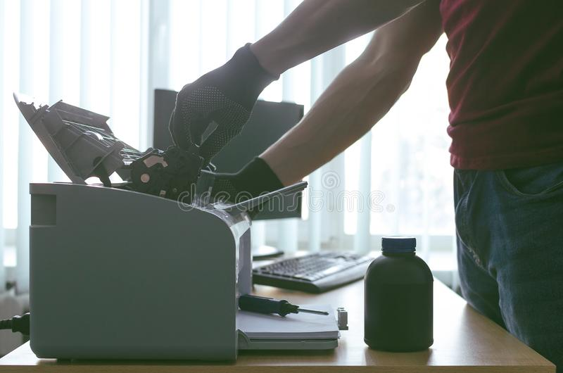 Laser printer cartridge repair. Laser cartridge toner refill concept. Office equipment maintenance concept stock images