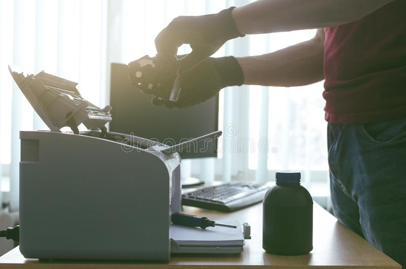 Laser printer cartridge repair. Laser cartridge toner refill concept. Office equipment maintenance concept royalty free stock images