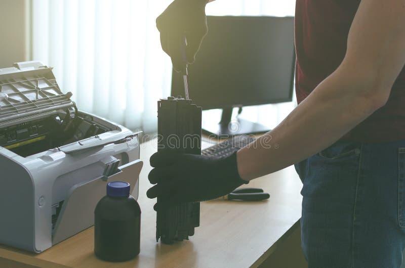 Laser printer cartridge repair. Laser cartridge toner refill concept. Office equipment maintenance concept stock photo