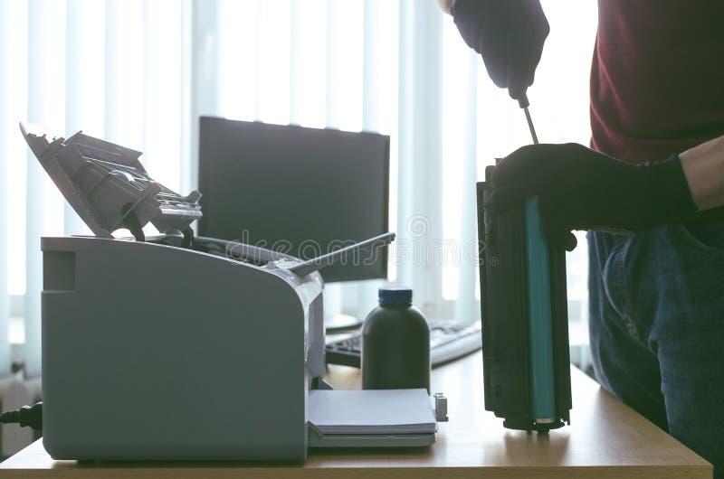 Laser printer cartridge repair. Laser cartridge toner refill concept. Office equipment maintenance concept stock image