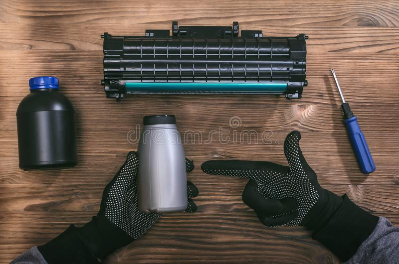 Laser printer cartridge repair. Laser cartridge toner refill concept. Office equipment maintenance concept royalty free stock photography