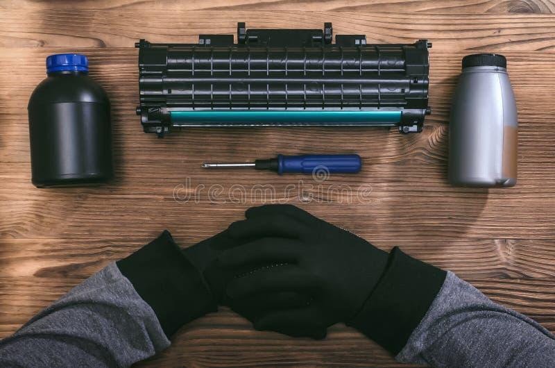 Laser printer cartridge repair. Laser cartridge toner refill concept. Office equipment maintenance concept stock photos