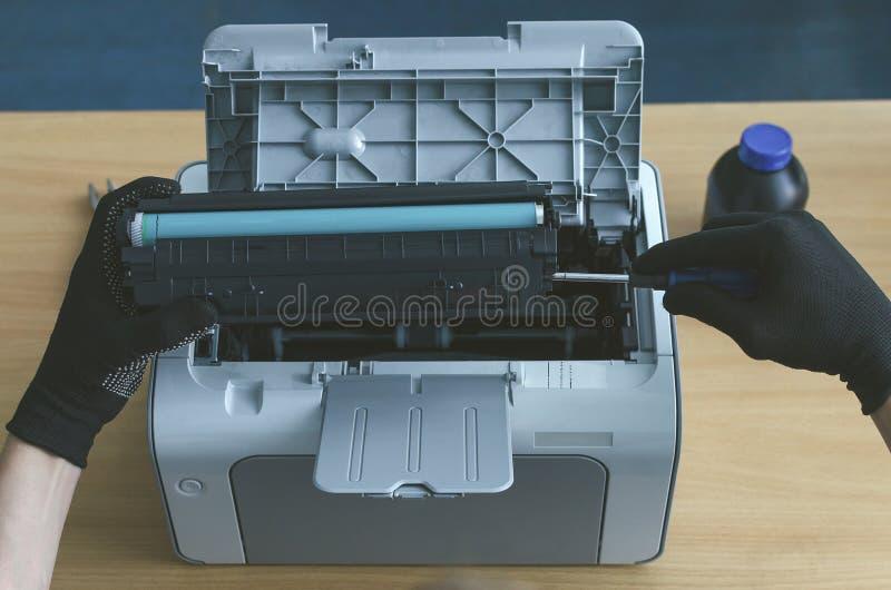 Laser printer cartridge repair. Laser cartridge toner refill concept. Office equipment maintenance concept royalty free stock photos