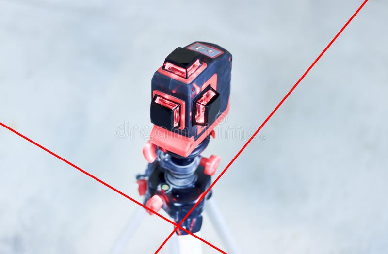 With a laser at the construction site. Close-up royalty free stock photo