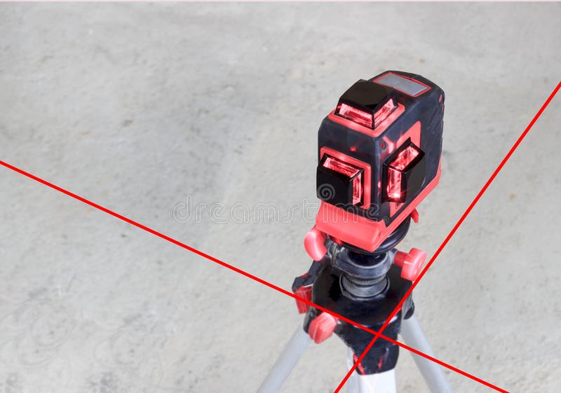 With a laser at the construction site. Close-up royalty free stock images