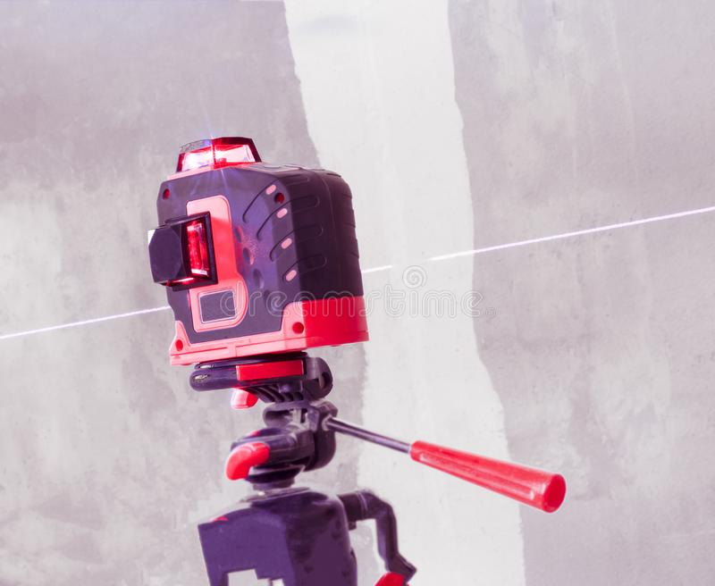 With a laser at the construction site. Close-up royalty free stock photography