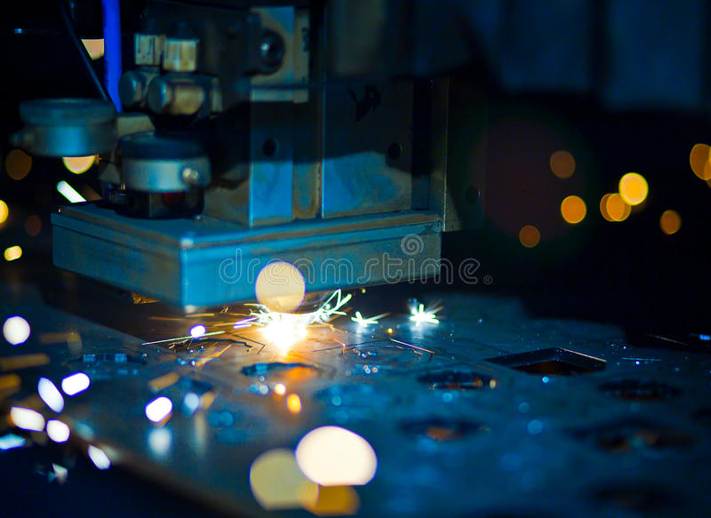 Laser cutting close up royalty free stock photography