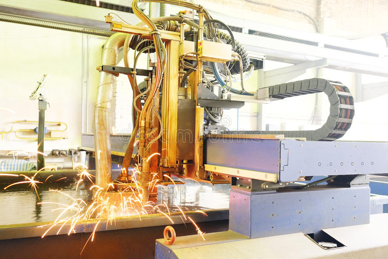 Laser cutting metal in water stock photo