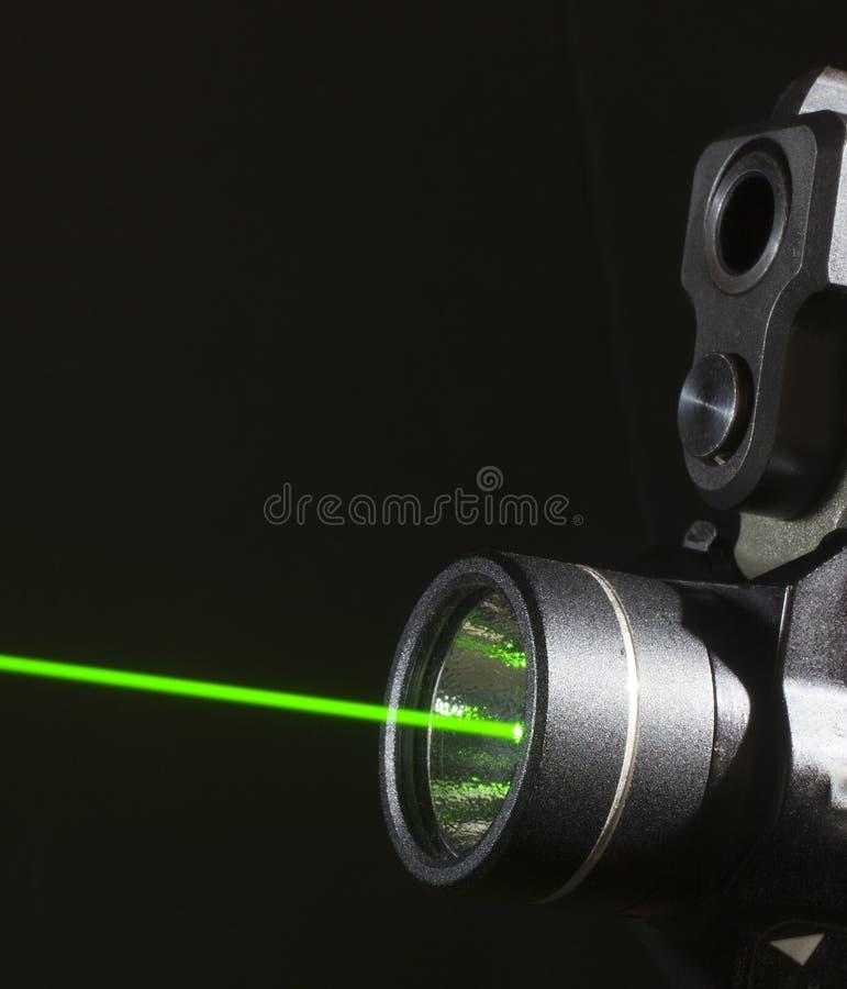 Laser do revólver fotografia de stock