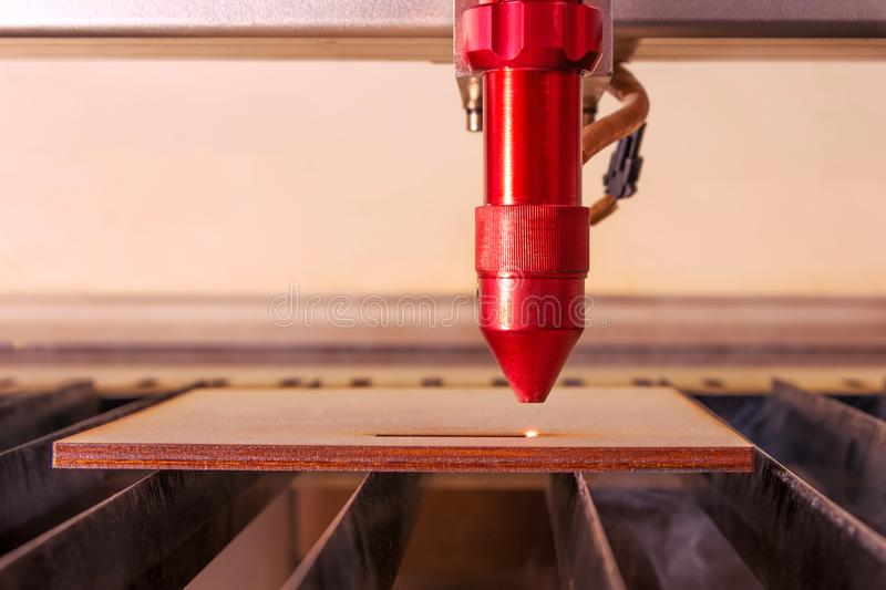 Laser Engraver Working And Engraving Flat Wooden Board Stock