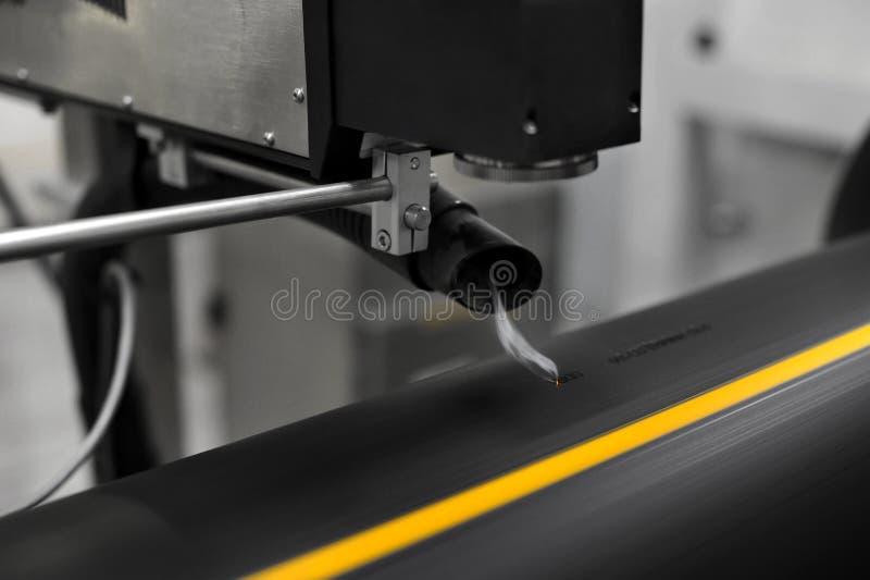 Laser-gravörarbete arkivbild