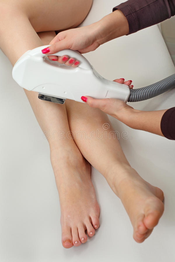 Laser hair removal. In professional studio royalty free stock images