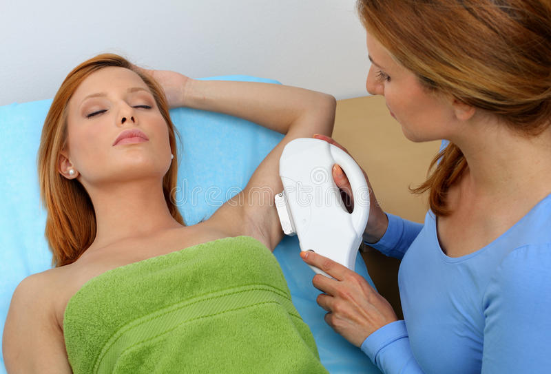 Laser hair removal. Armpit - in professional studio royalty free stock photo