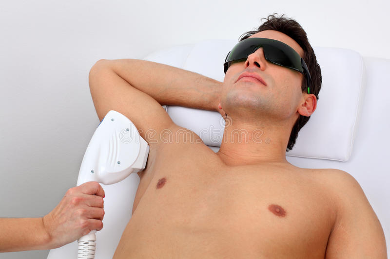 Laser hair removal. In professional studio royalty free stock photography