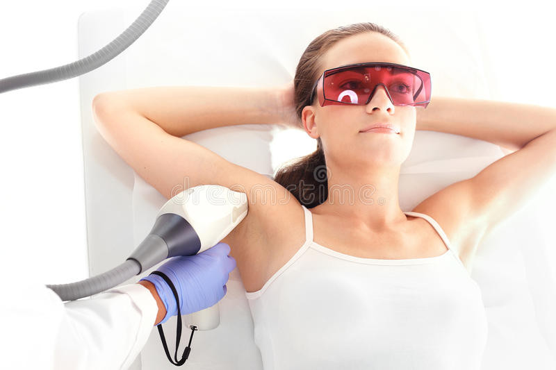 Laser hair removal armpits. Woman on laser hair removal royalty free stock photos