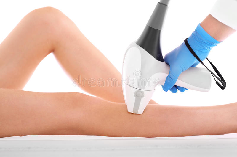 Laser hair removal. Woman on laser hair removal legs royalty free stock images