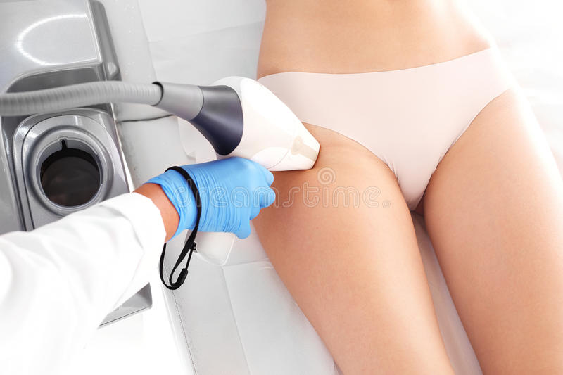 Laser hair removal. Woman on laser hair removal treatments thighs and bikini area royalty free stock photos