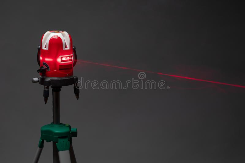 Laser level tool red light beam, grey background stock image