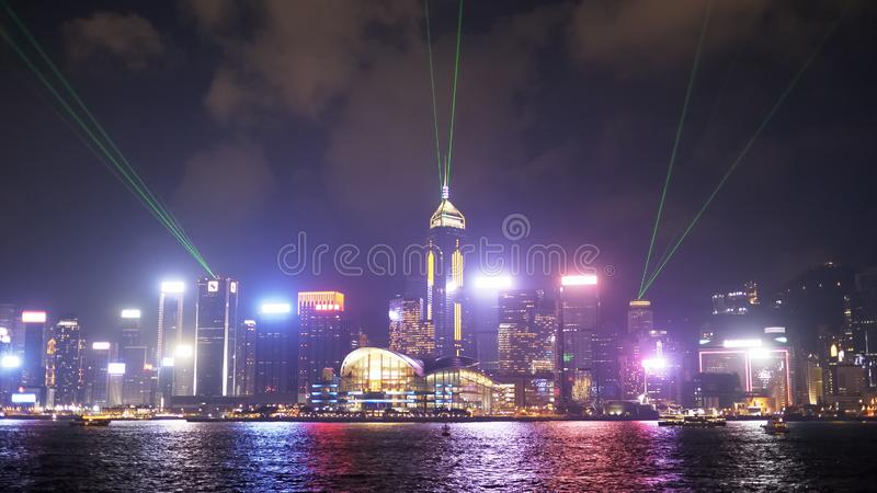 A laser light show at victoria harbour in hong kong, china royalty free stock images