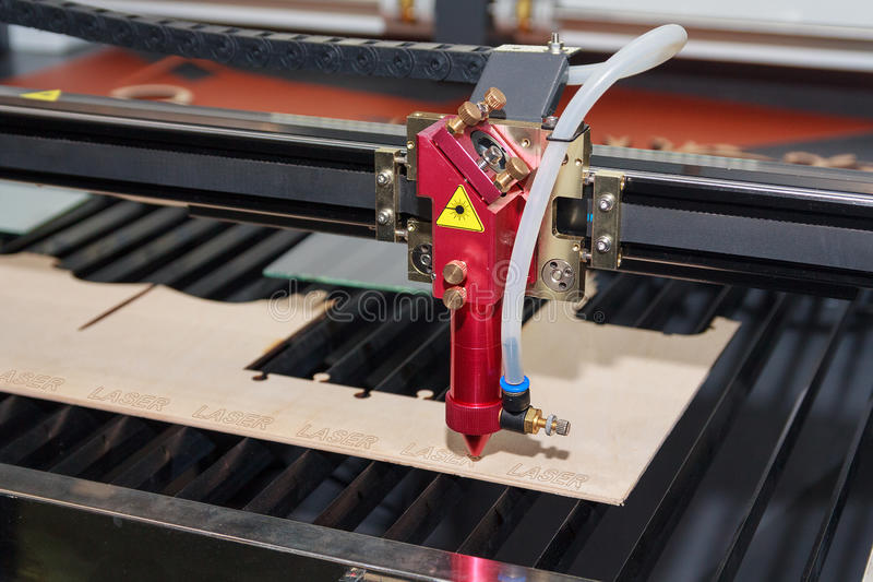 Laser machine for cutting and engraving plywood stock image