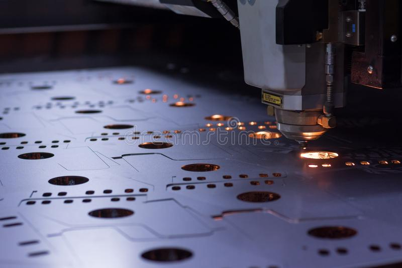 Laser machine cutting of sheet metal. stock images
