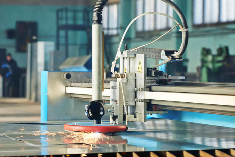 Laser or plasma cutting of metal sheet with sparks stock photo