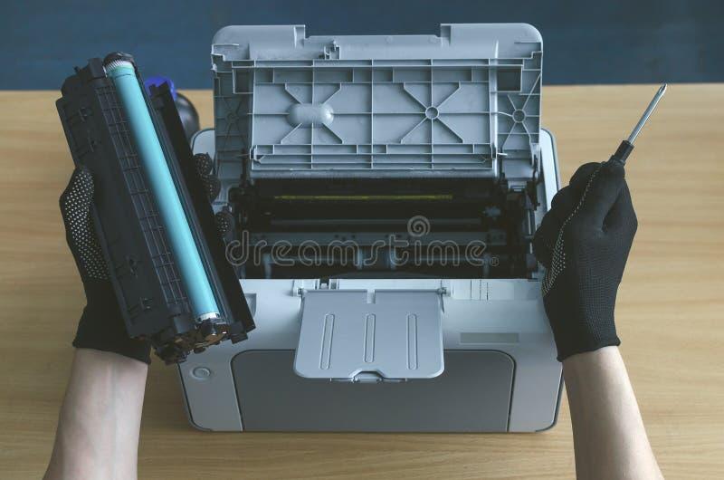 Laser printer cartridge repair. Laser cartridge toner refill concept. Office equipment maintenance concept stock photography