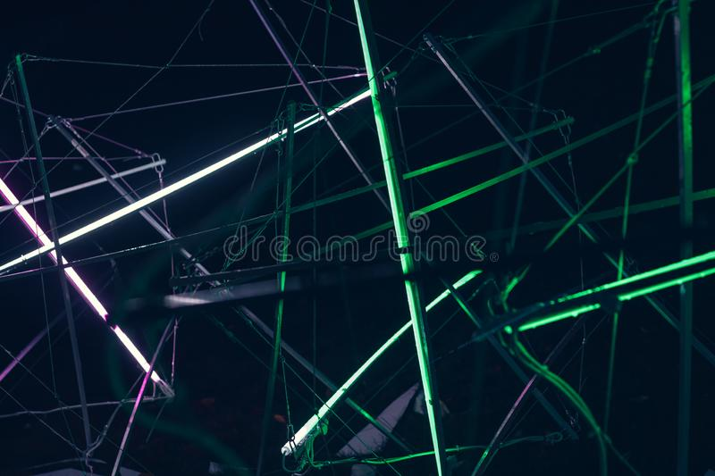 Laser show, night club interior lights, glowing lines, abstract fluorescent background royalty free stock image