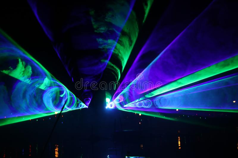 Laser show during public free event on public street and water with small ships parad royalty free stock photo