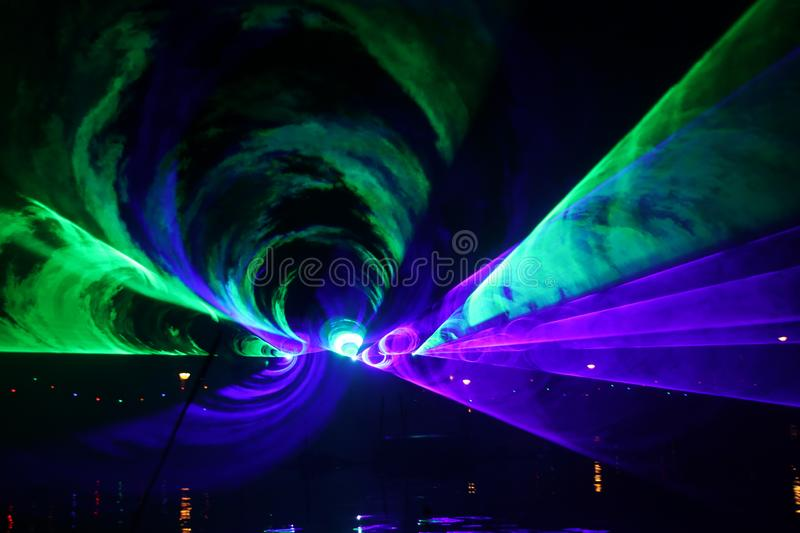 Laser show during public free event on public street and water with small ships parad stock photography