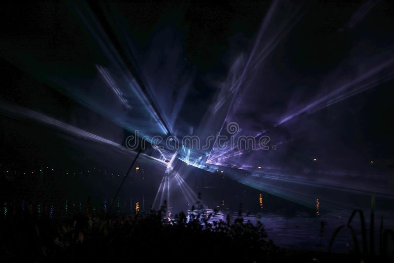 Laser show during public free event on public street and water with small ships parad stock photos