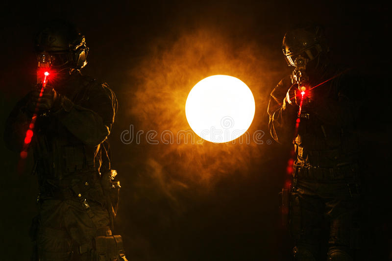 Laser sights in the smoke stock photography
