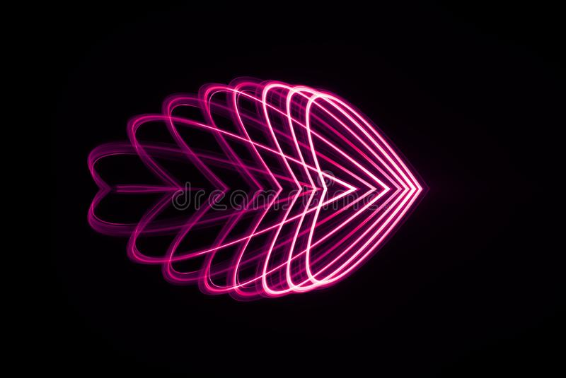 Laser Spirograph in in red and pink light expanded in various heart shapes. A spirograph made with a red and pink led light that looks like a laser in a heart royalty free stock images