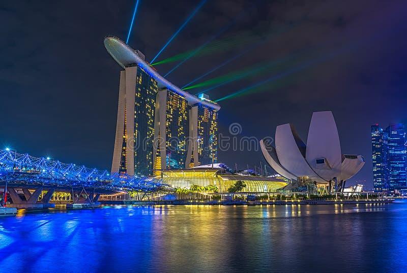 Laser Whow på Marina Bay Sands Hotel på 26 mars 2016 fotografering för bildbyråer